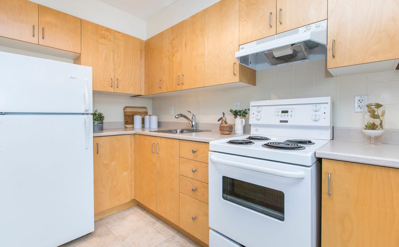 Clean and updated appliances in large kitchen