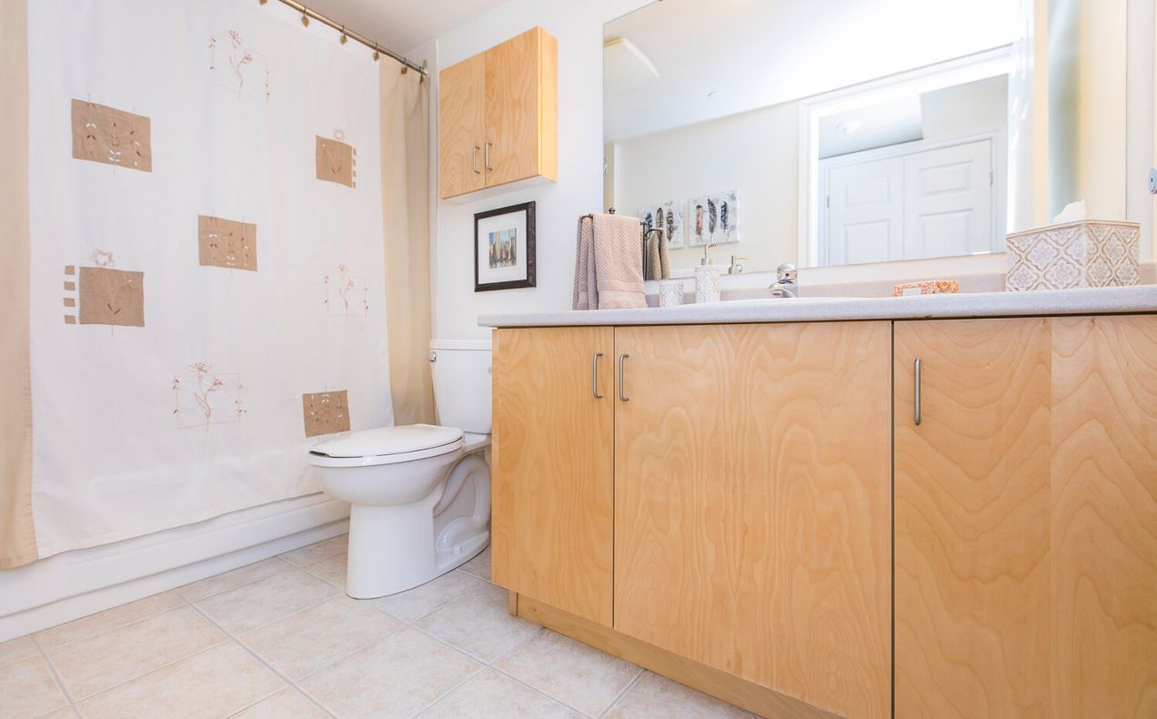 Clean bathroom with shower in a bachelor/studio apartment