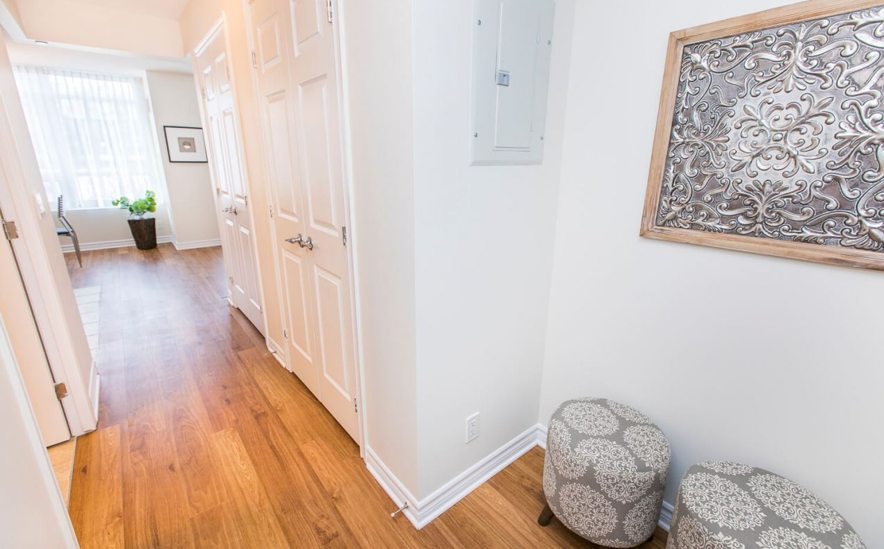 Hallway with plenty of closet space in a bachelor/studio apartment
